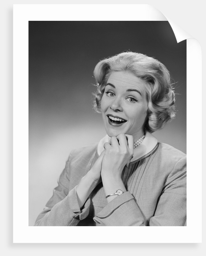Woman clasped hand by chin with wishful hoping happy joyful facial expression by Corbis