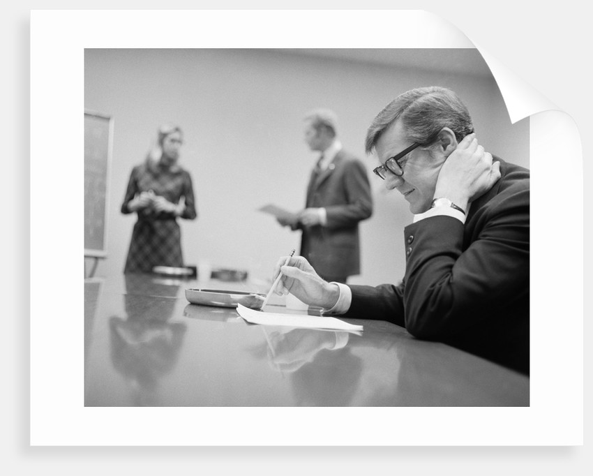 Worried Businessman Seated Conference Table Two People In Background - 14 person conference table