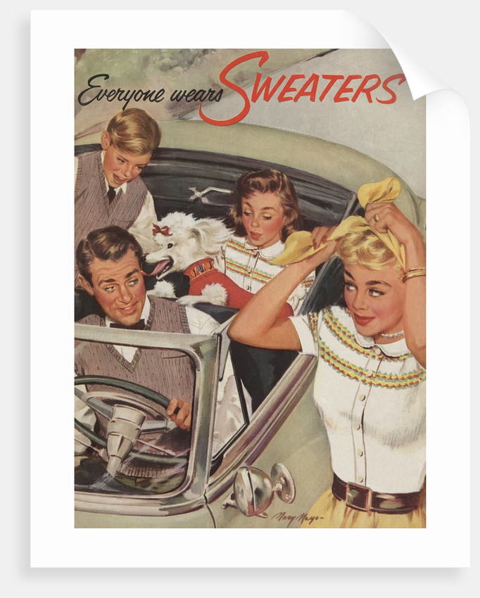 Family wearing sweaters in convertible by Corbis