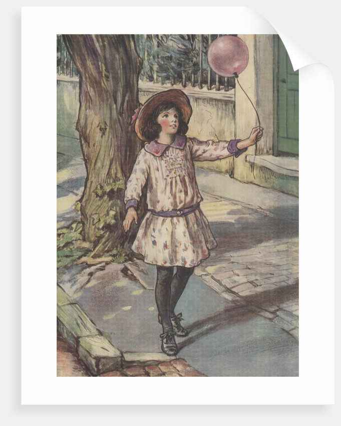Girl holding balloon by Corbis