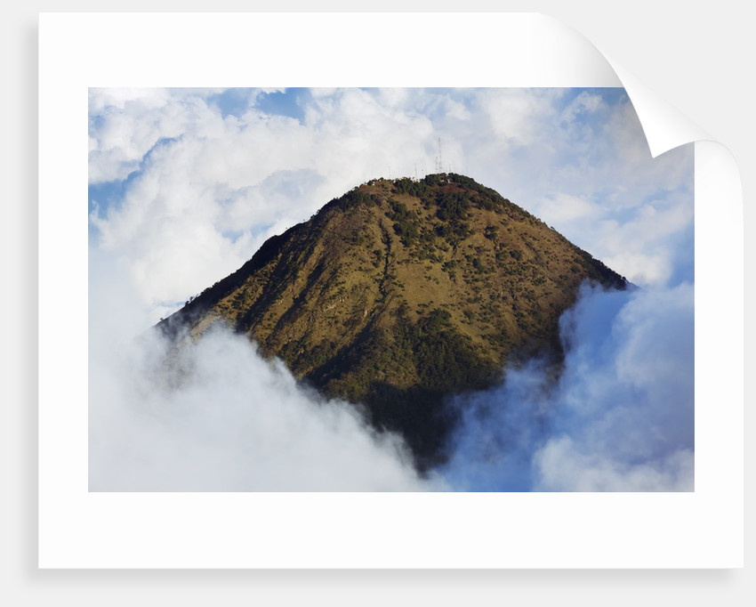 Landscape with Agua volcano surrounded by clouds by Corbis