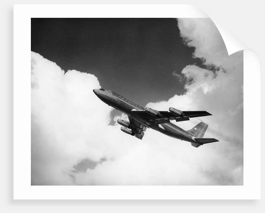 1960s american airlines a-707 jet ascending through clouds by Corbis
