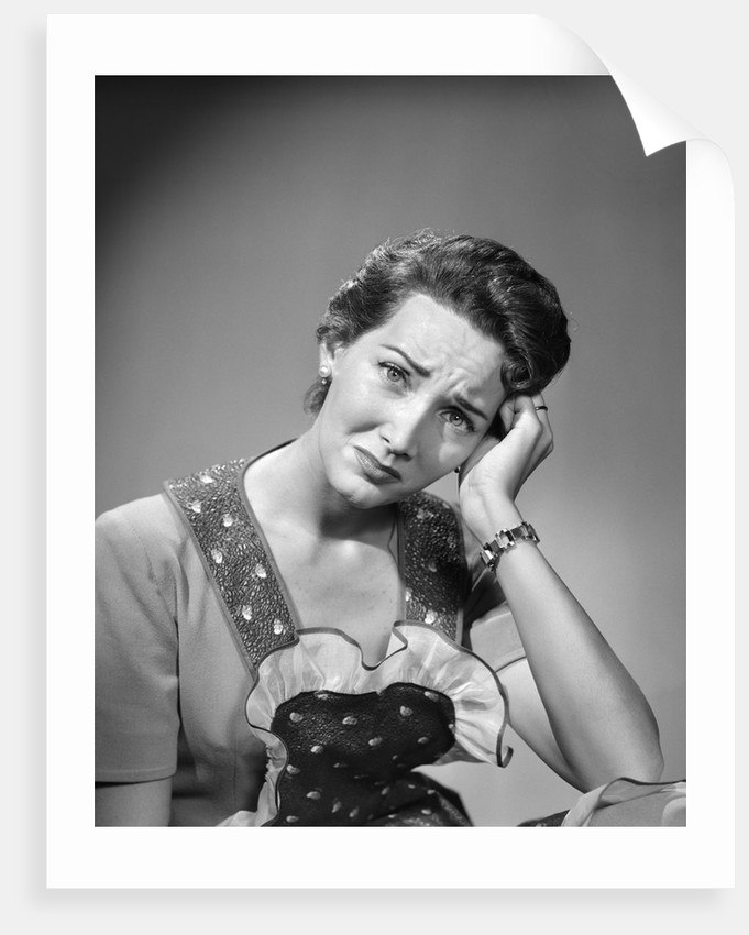 1950s housewife woman in print apron hand up to temple headache pain sad depressed facial expression