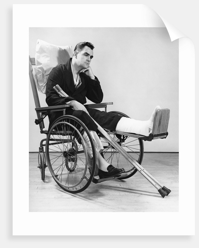1940s Man In Wheelchair With Cast On Left Leg Holding