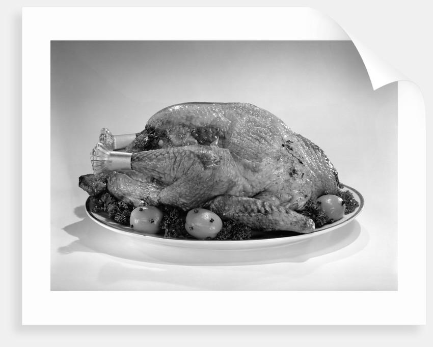 1950s roasted turkey on a platter by Corbis
