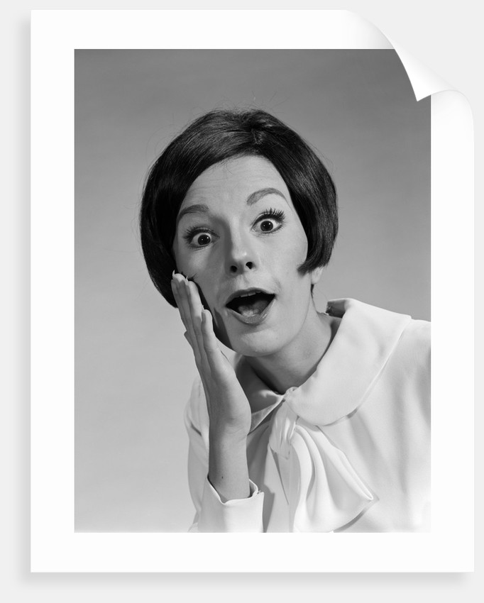 1960s brunette woman mouth agape eyes wide hand to cheek funny face expression shock surprise anger amazed by Corbis