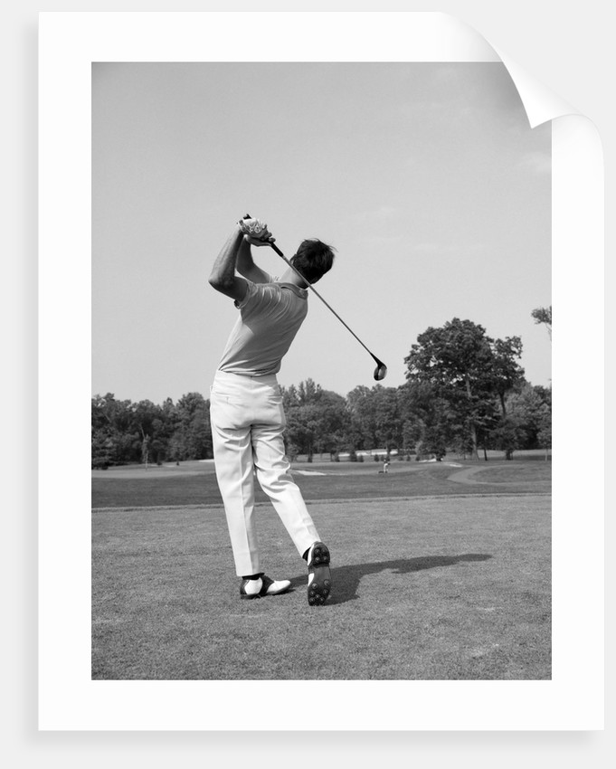 1970s man swing golf club by corbis