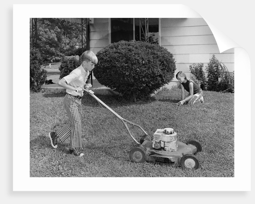 1970s brother and sister doing chores mowing lawn cutting grass yard work together by Corbis