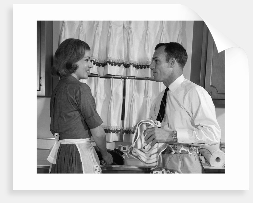 1960s man woman washing dishes kitchen sink by corbis