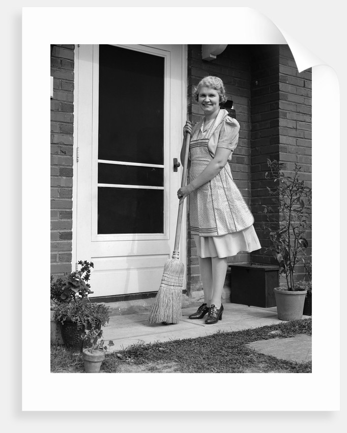 1940s Smiling Woman Sweeping Porch Front Door Step With A Broom
