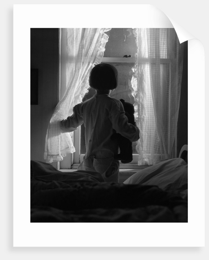 1920s Child Looking Out Window At Night Posters Prints By Corbis