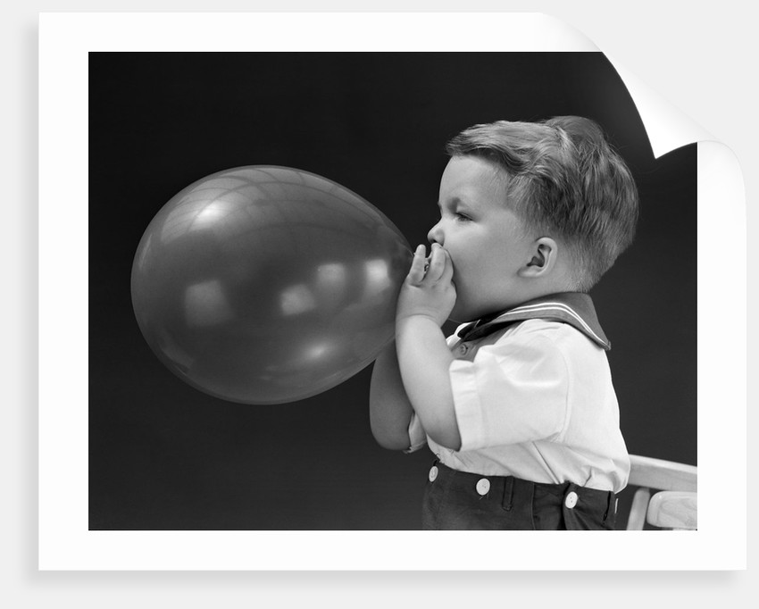 1940s Boy Blowing Up Balloon Posters Prints By Corbis