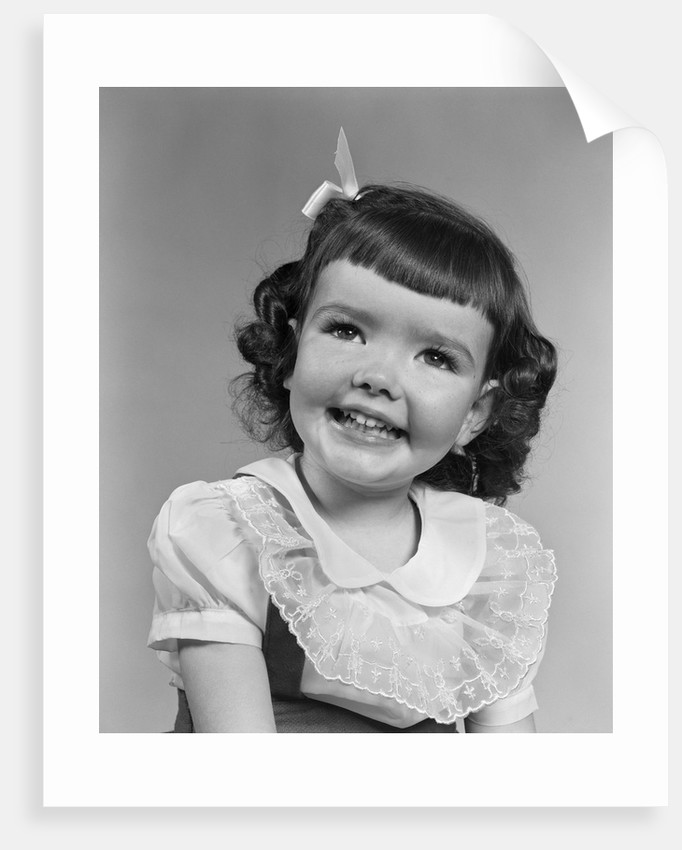 1950s smiling brunette girl with bangs by Corbis