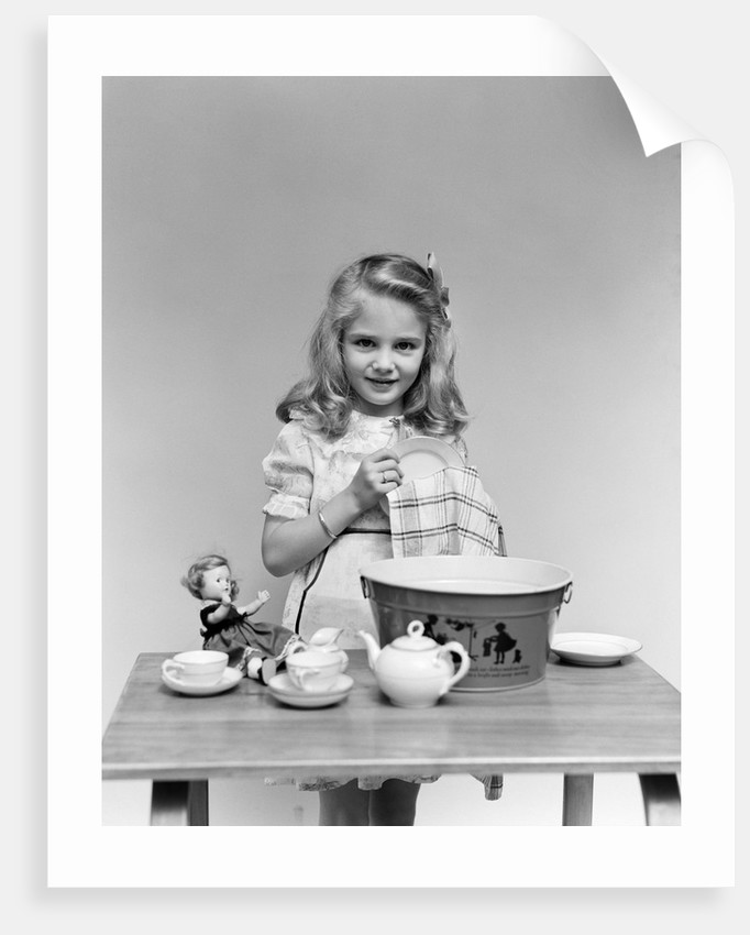 1940s child little girl and doll drying washing toy dishes by Corbis