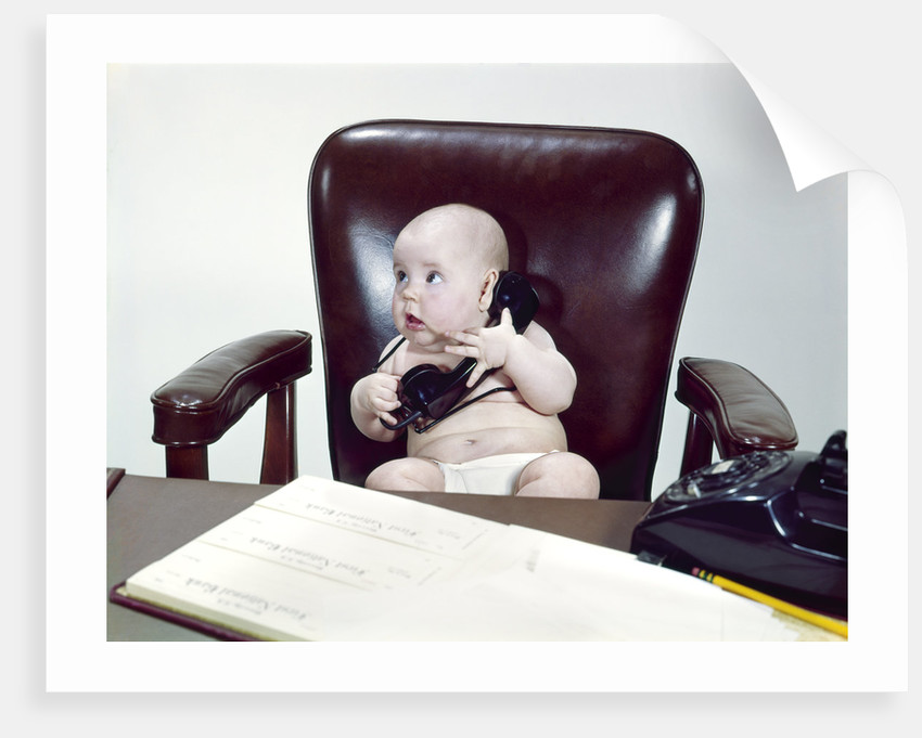 1960s Baby Sitting In Leather Chair At Office Desk Holding Telephone By Corbis