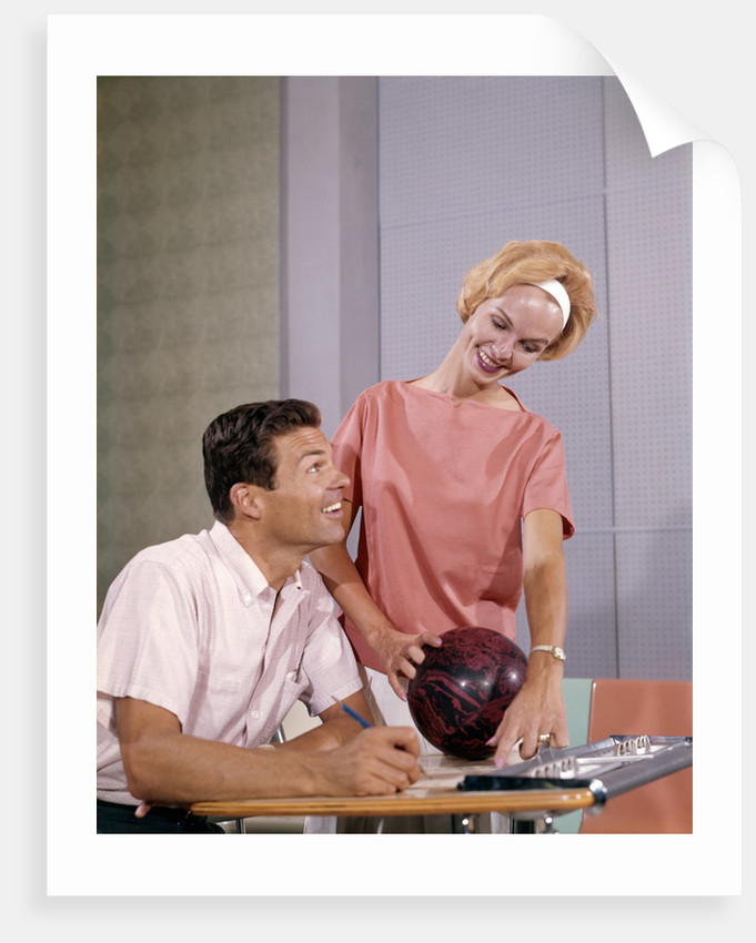 1960s couple husband wife bowling checking the score indoor by Corbis