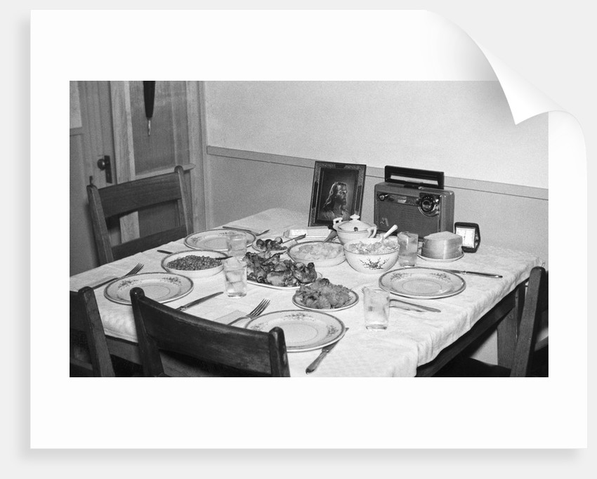 Jesus watches over the dinner table, ca. 1956. by Corbis