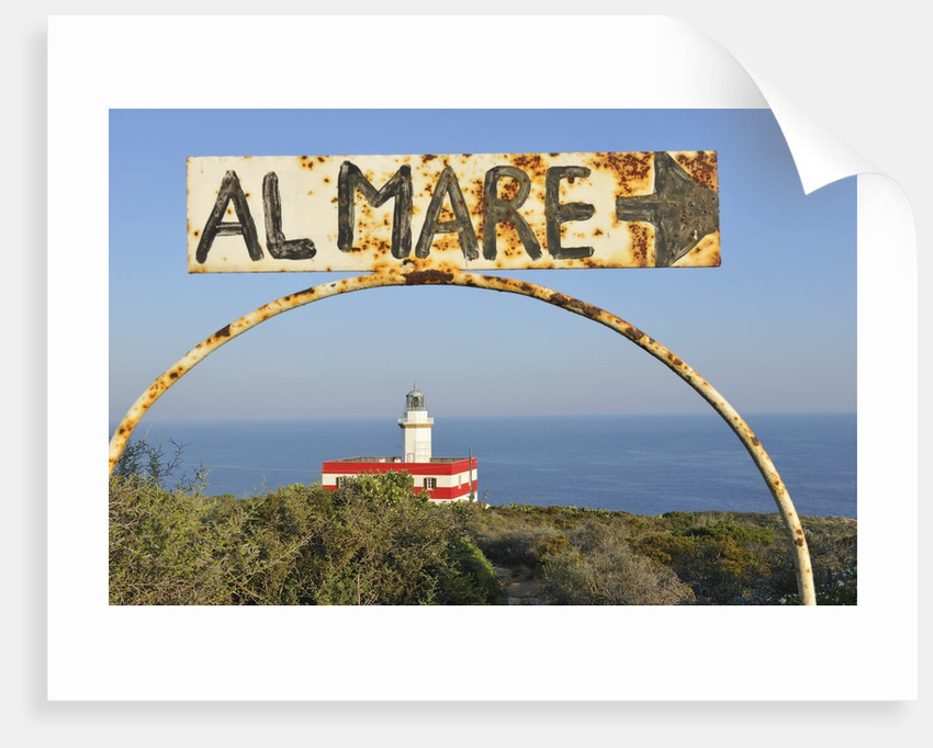 Lighthouse with rusty sign, Punta Capel Rosso, Italy by Corbis