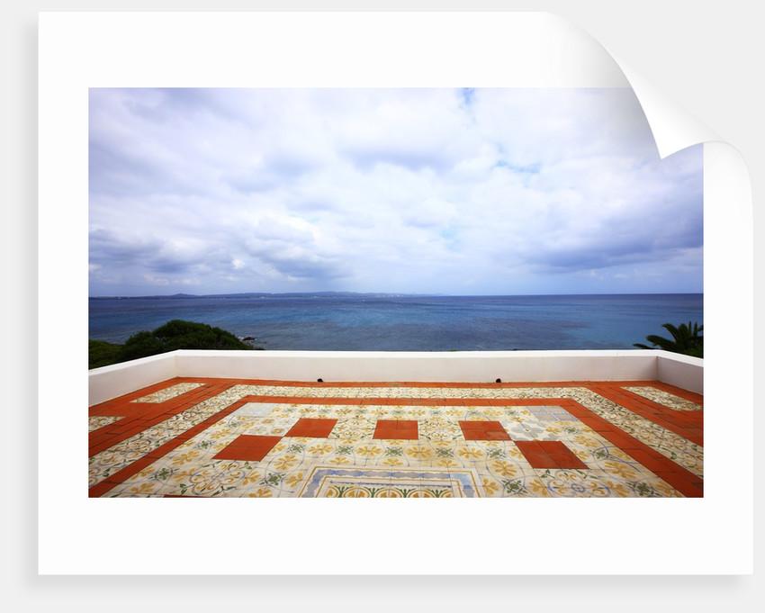 Tiled tarrace overlooking sea, San Pietro island, Carloforte, Sardinia, Italy by Corbis