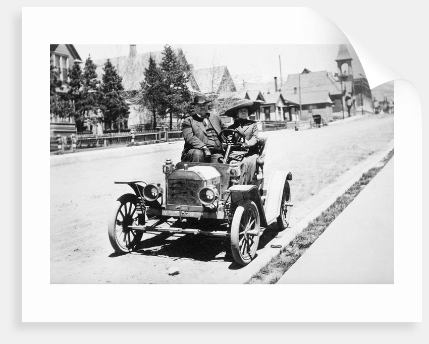 Mature couple in a car, ca. 1910 by Corbis