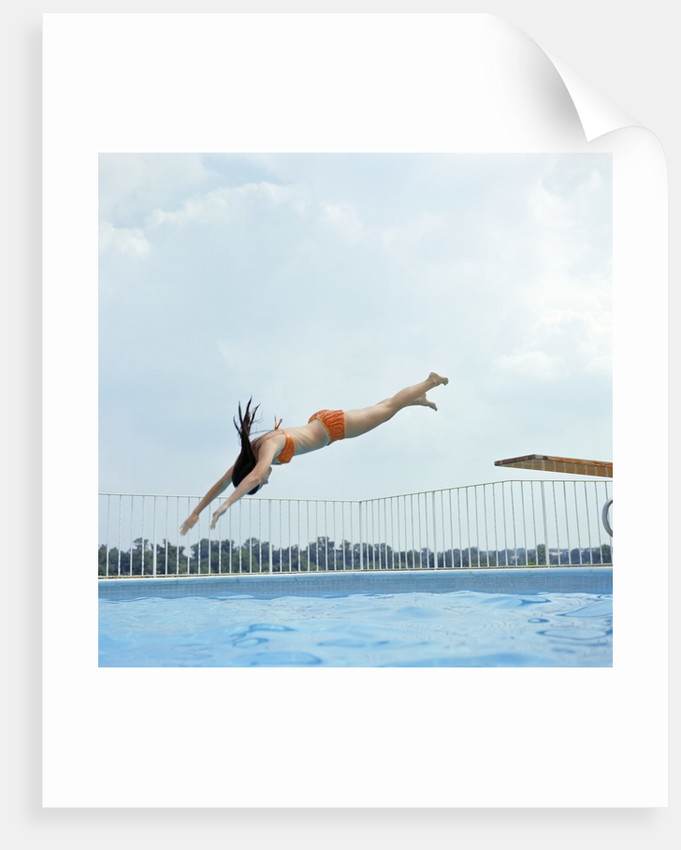 1970s Teen Girl Diving Into Swimming Pool by Corbis