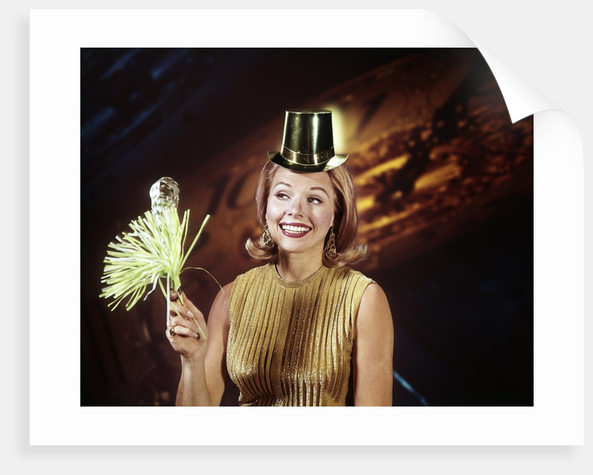 1960s Young Blonde Woman Party Hat Noisemaker Horn Smiling New Year Clock Background by Corbis