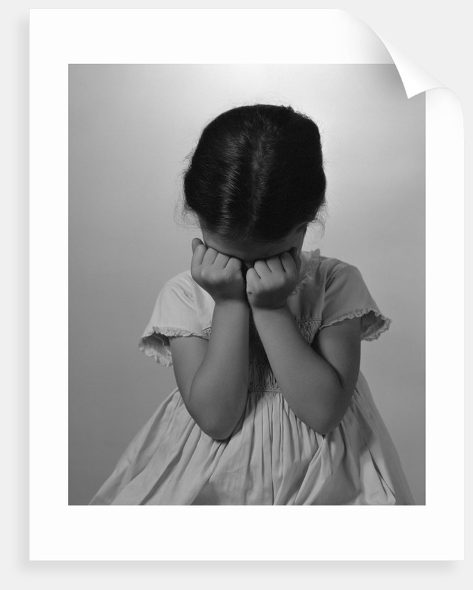 1960s Sad Little Girl Sitting Hands On Face Crying by Corbis