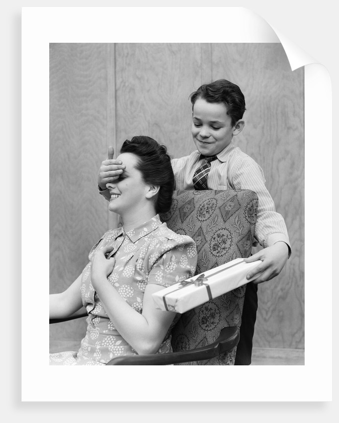 1930s 1940s Boy Son Surprising Woman Mother With Gift Wrapped Present by Corbis