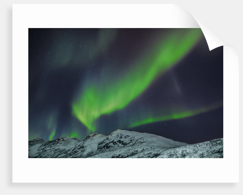 Polar light over snowcovered mountains by Corbis