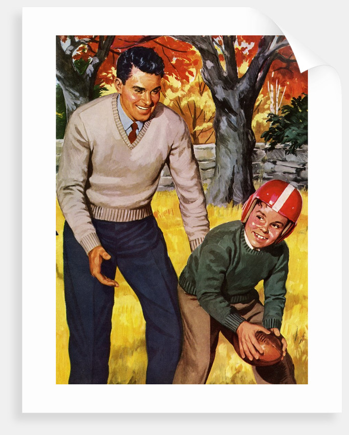 Father and Son Playing Football by Corbis