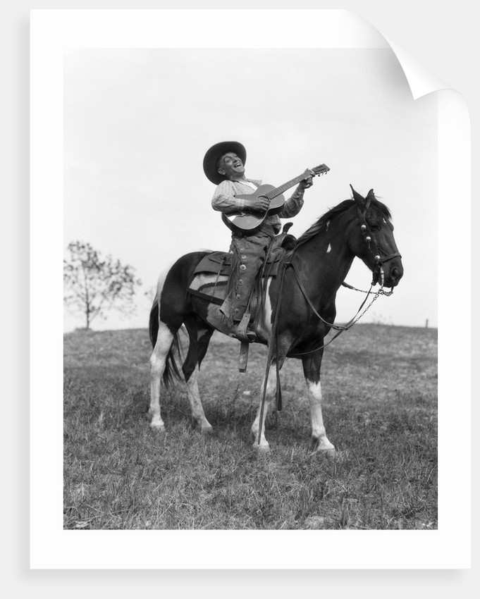 1920s Cowboy On Horse Singing And Playing Guitar Posters Prints By