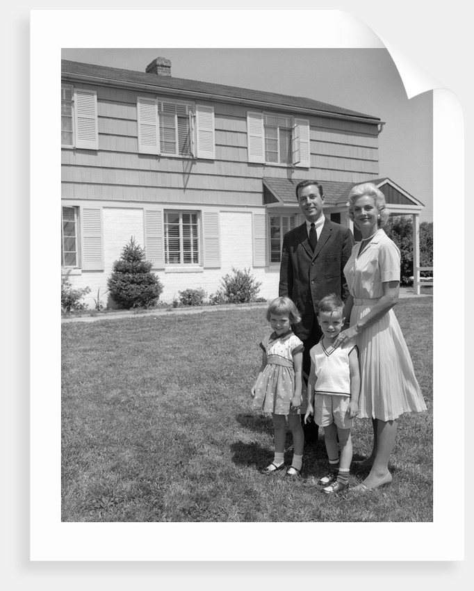 1960s family portrait in front of suburban home by corbis