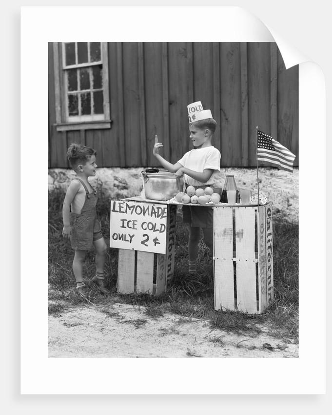 1940s boy running lemonade stand by Corbis