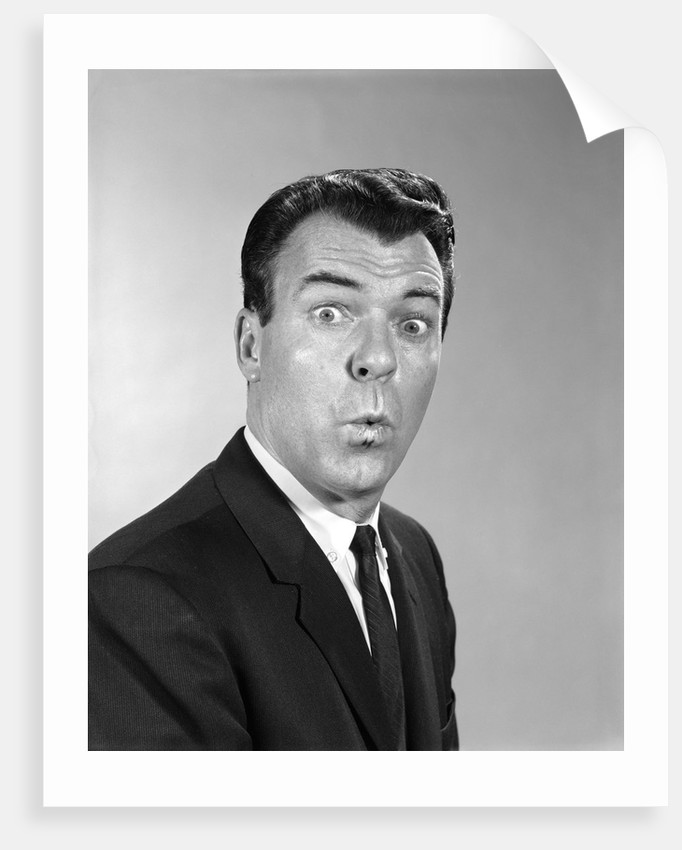 1960s man making a funny face by Corbis