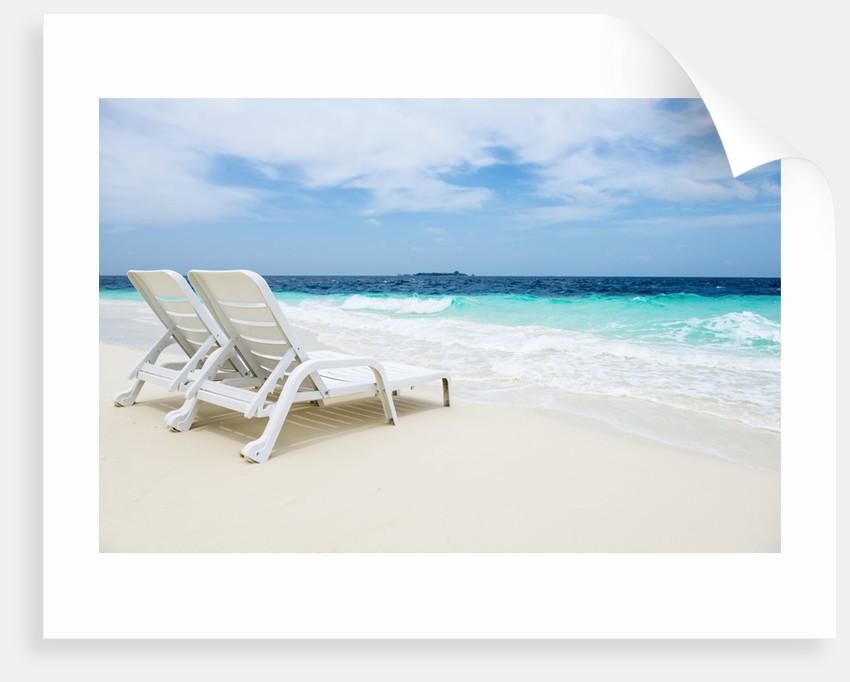 Idyllic beach scene in the Maldives by Corbis