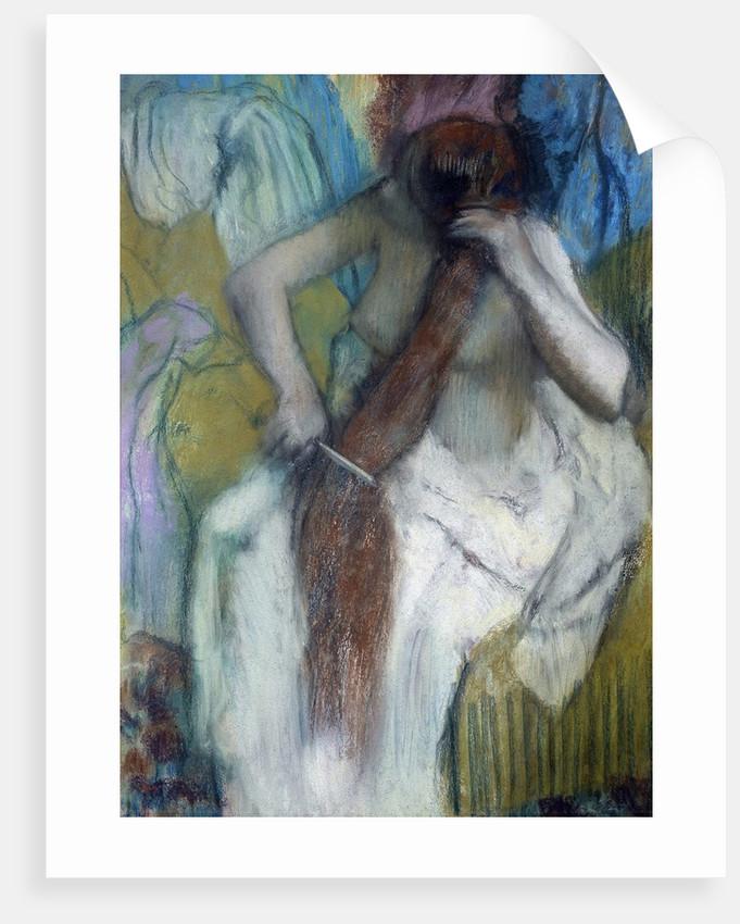 Woman combing her hair - by Edgar Degas