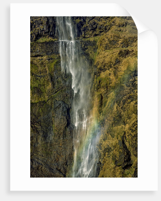 Aerial view of a waterfall and rainbow in the Eyjafjoll area, Iceland by Corbis