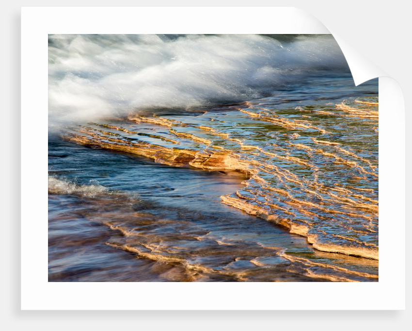 Eroded sandstone beach on the shore of lake superior at Miners beach in Picture Rock National Seash by Corbis