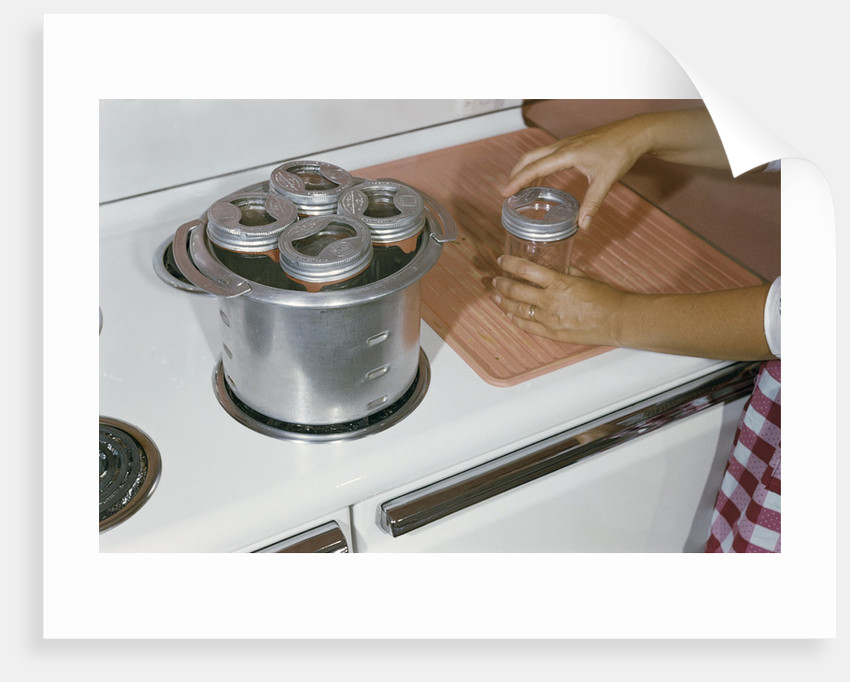 Woman Sterilizing Jars for Canning by Corbis