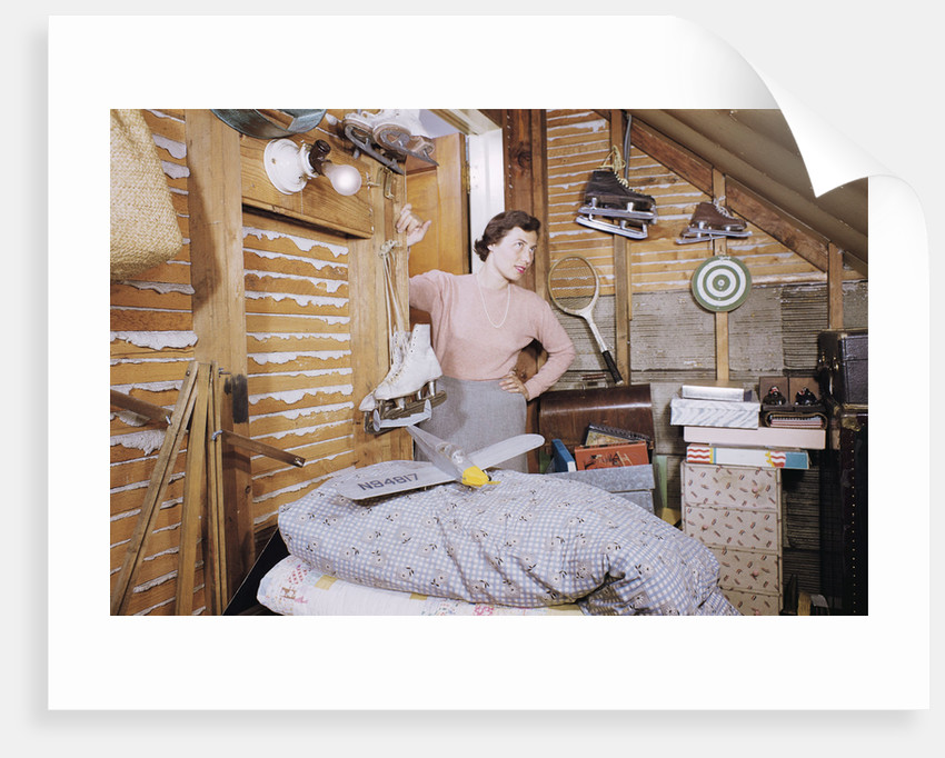 Woman Standing in an Attic by Corbis