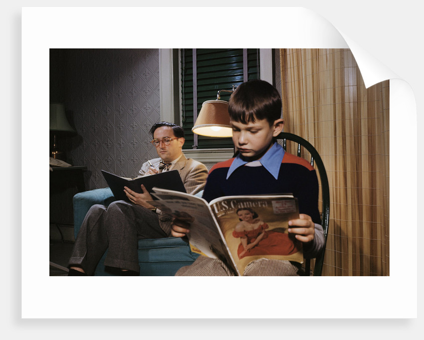 Father and Son Reading at Home by Corbis