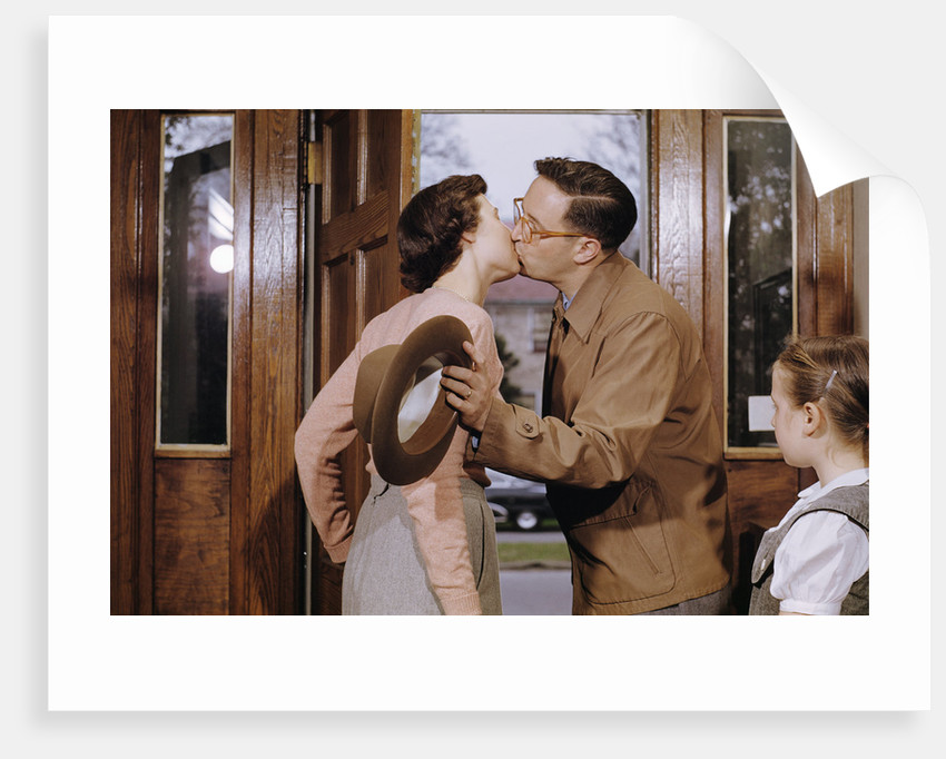 Husband and Wife Kissing Goodbye by Corbis