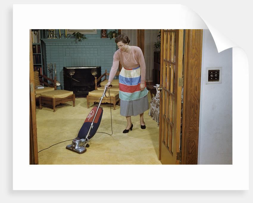Woman Vacuuming Living Room by Corbis