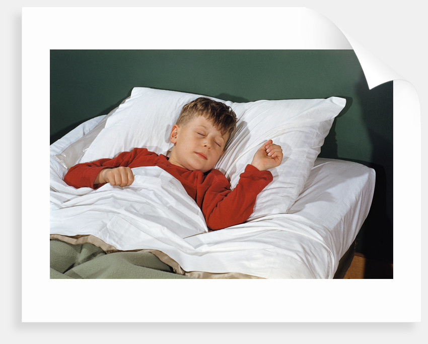 Child Sleeping in Bed by Corbis