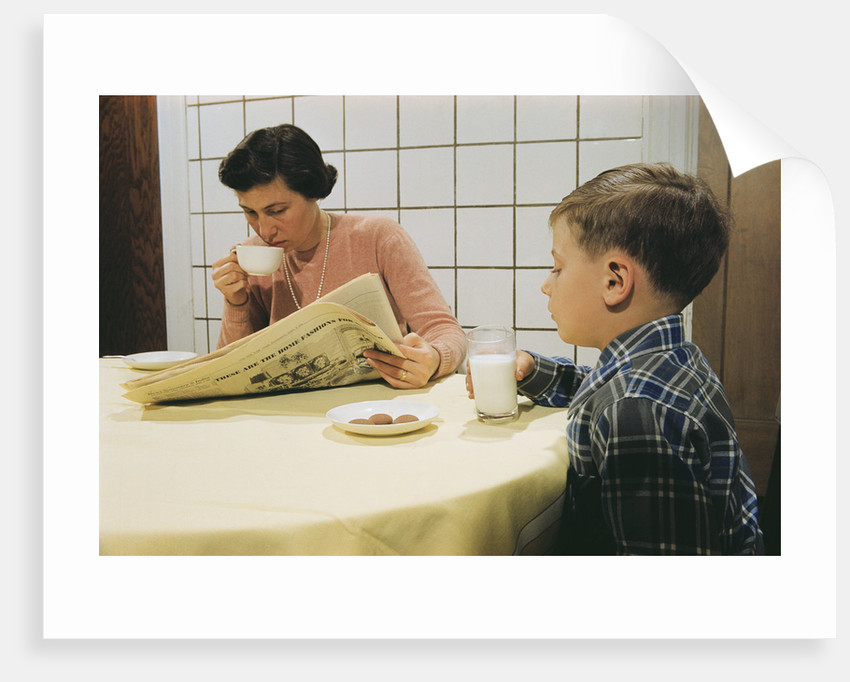 Boy Eating Cookies and Milk as Mom Reads by Corbis