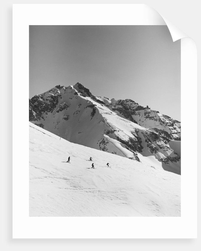 Skiers Skiing Down Mountain by Corbis