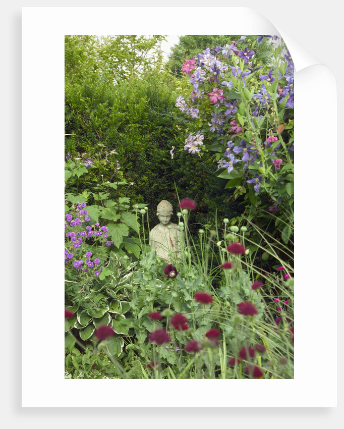 Small Statue in a Back Garden by Corbis