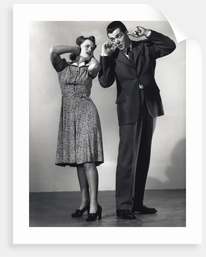 Woman and Man With Hands Over Ears by Corbis