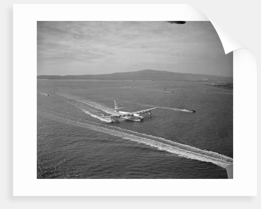 Howard Hughes' Spruce Goose Taxiing Across Water by Corbis
