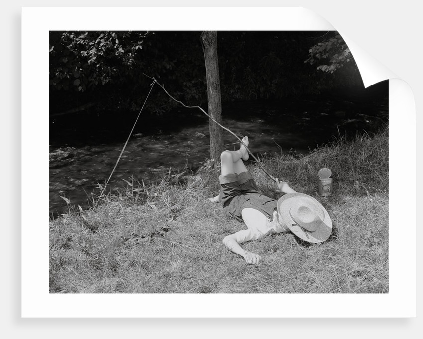 Boy Fishing in the Country by Corbis